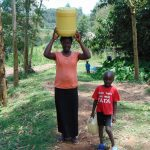 The Water Project: Bukhaywa Community, Ashikhanga Spring -  Carrying Water