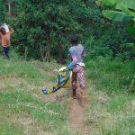 The Water Project: Kimaran Community, Kipsiro Spring -  Running To The Spring