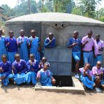 The Water Project: Kapchorwa Primary School -  Students With Completed Tank