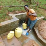 The Water Project: Mutao Community, Kenya Spring -  Happy Filling Up