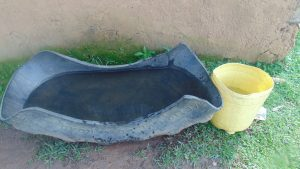 The Water Project:  Trough Used To Collect Rain Water