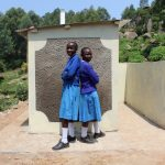 The Water Project: Kapchorwa Primary School -  Girls In Front Of New Latrines