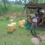 The Water Project: Mukangu Community, Metah Spring -  Child And Water Containers