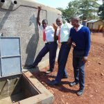 The Water Project: Ikumba Secondary School -  Boys At The Rain Tank
