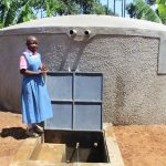 The Water Project: Irovo Orphanage Academy -  Student At Rain Tank