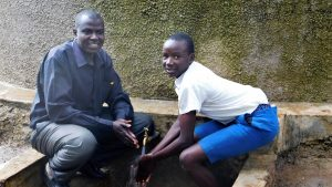 The Water Project:  Deputy Head Teacher Godfrey Ochieng With Student