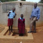 The Water Project: Namalasire Primary School -  Mr Mango With Students At The Tank