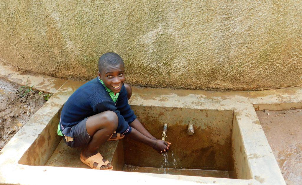 The Water Project : 3-kenya18039-student-at-rain-tank