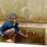 The Water Project: Shitsava Primary School -  Student At Rain Tank