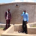 The Water Project: Joyland Special Secondary School -  Field Officer Samuel Samidi With Student Solomon Otieno