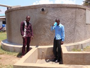 The Water Project:  Field Officer Samuel Samidi With Student Solomon Otieno