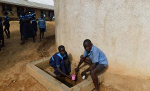 The Water Project:  Students Get A Drink From The Rain Tank