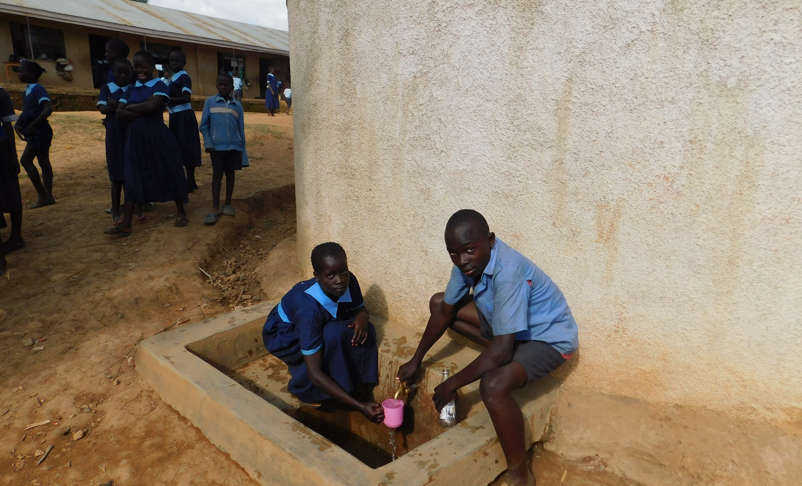 The Water Project : 3-kenya18043-students-get-a-drink-from-the-rain-tank