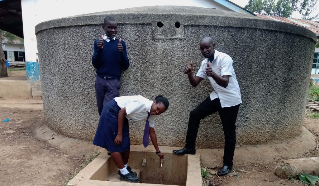 The Water Project : 3-kenya18045-alice-at-the-tap-with-another-student-and-kipchoge
