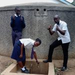 The Water Project: Essaba Secondary School -  Alice At The Tap With Another Student And Kipchoge