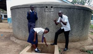 The Water Project:  Alice At The Tap With Another Student And Kipchoge