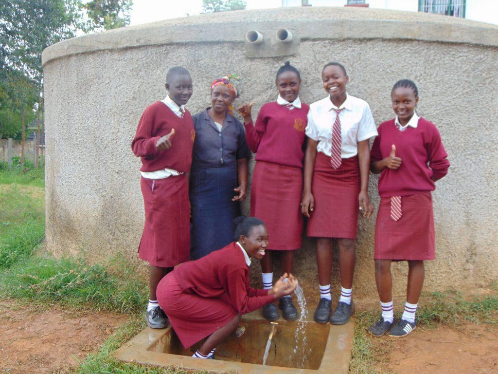 The Water Project : 3-kenya18046-mrs-ayodi-and-students-at-the-rain-tnak