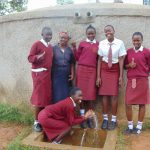 The Water Project: Shikhondi Girls Secondary School -  Mrs Ayodi And Students At The Rain Tnak