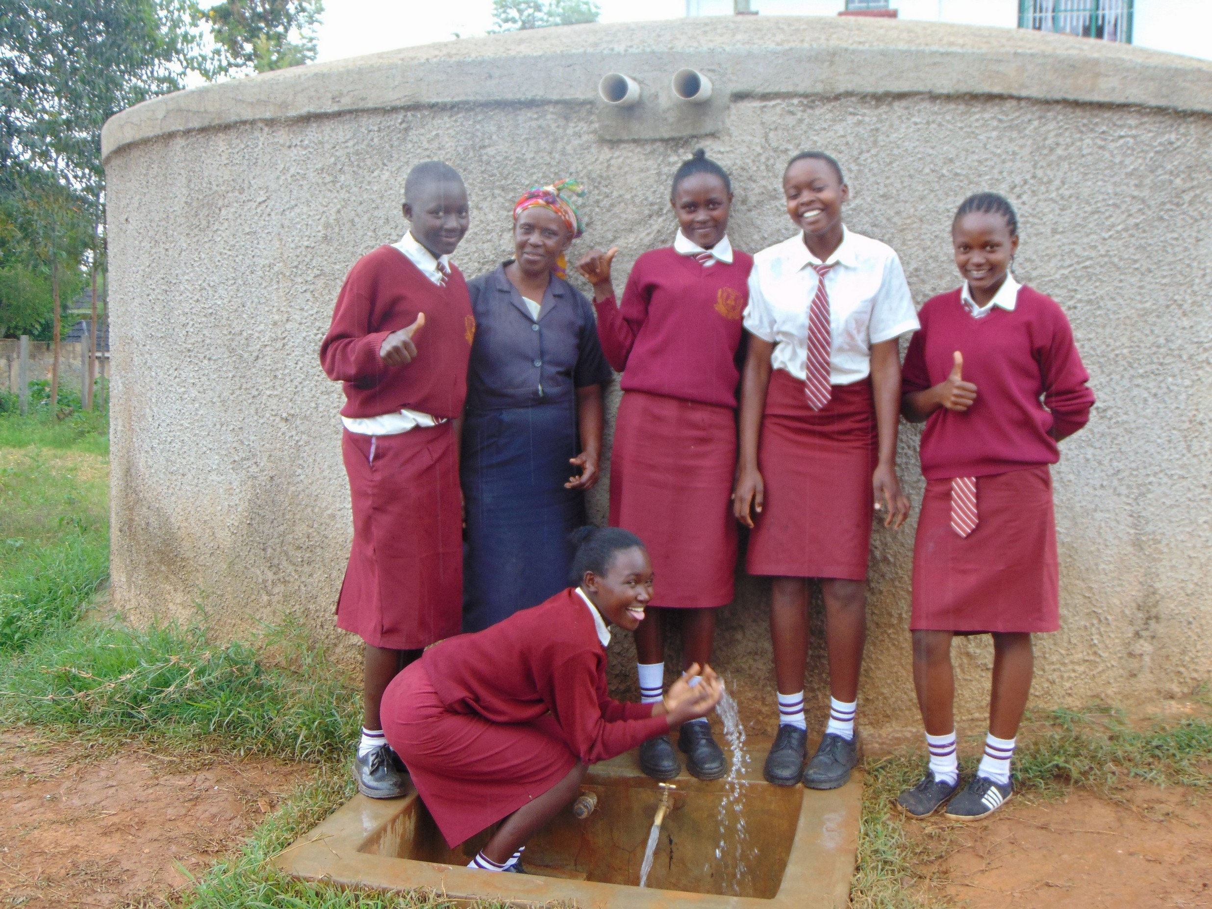The Water Project : 3-kenya18046-mrs-ayodi-and-students-at-the-rain-tnak