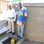 The Water Project: Bushili Primary School -  Field Officer Jonathan Mutai With Head Teacher Ronald Mashishia