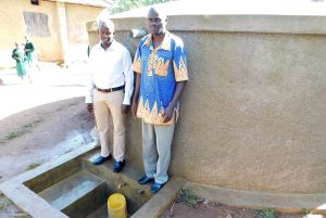 The Water Project:  Field Officer Jonathan Mutai With Head Teacher Ronald Mashishia