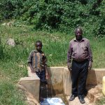 The Water Project: Lwenya Community, Warosi Spring -  Timothy Alulu And Mr Luvembe