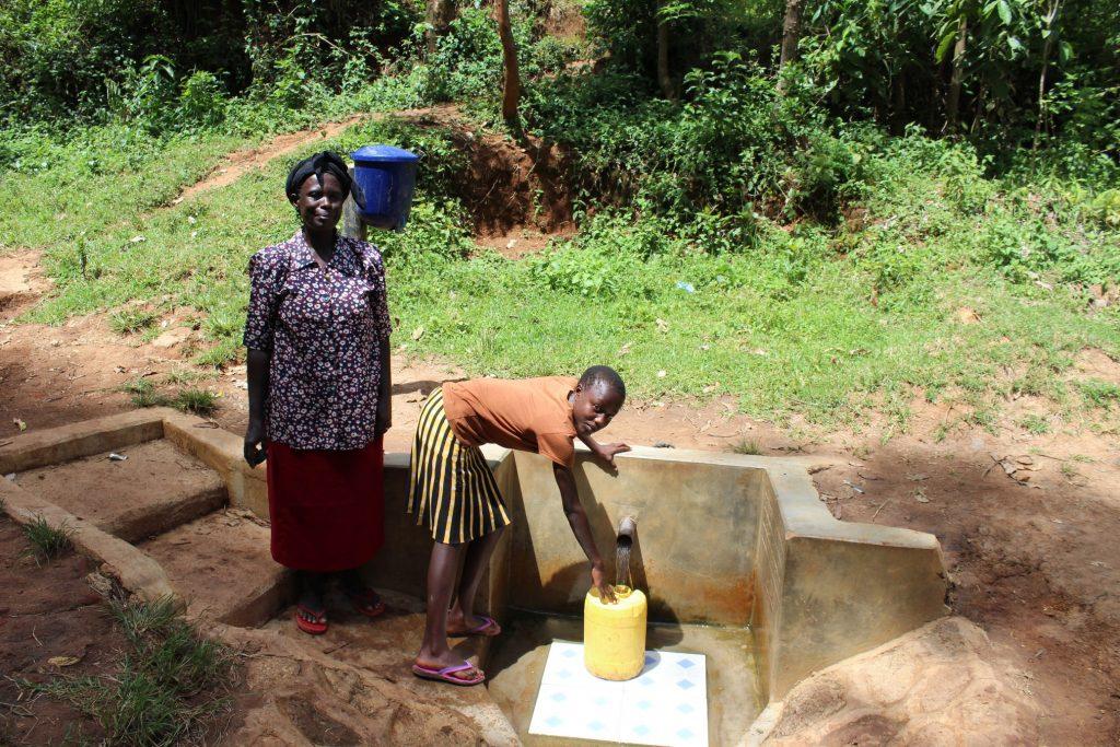 The Water Project : 3-kenya18098-margaret-with-faith-lumanye-jumba