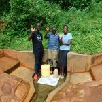 The Water Project: Emwanya Community, Josam Kutsuru Spring -  Field Officer Erick Wagaka With Aineas And Christine