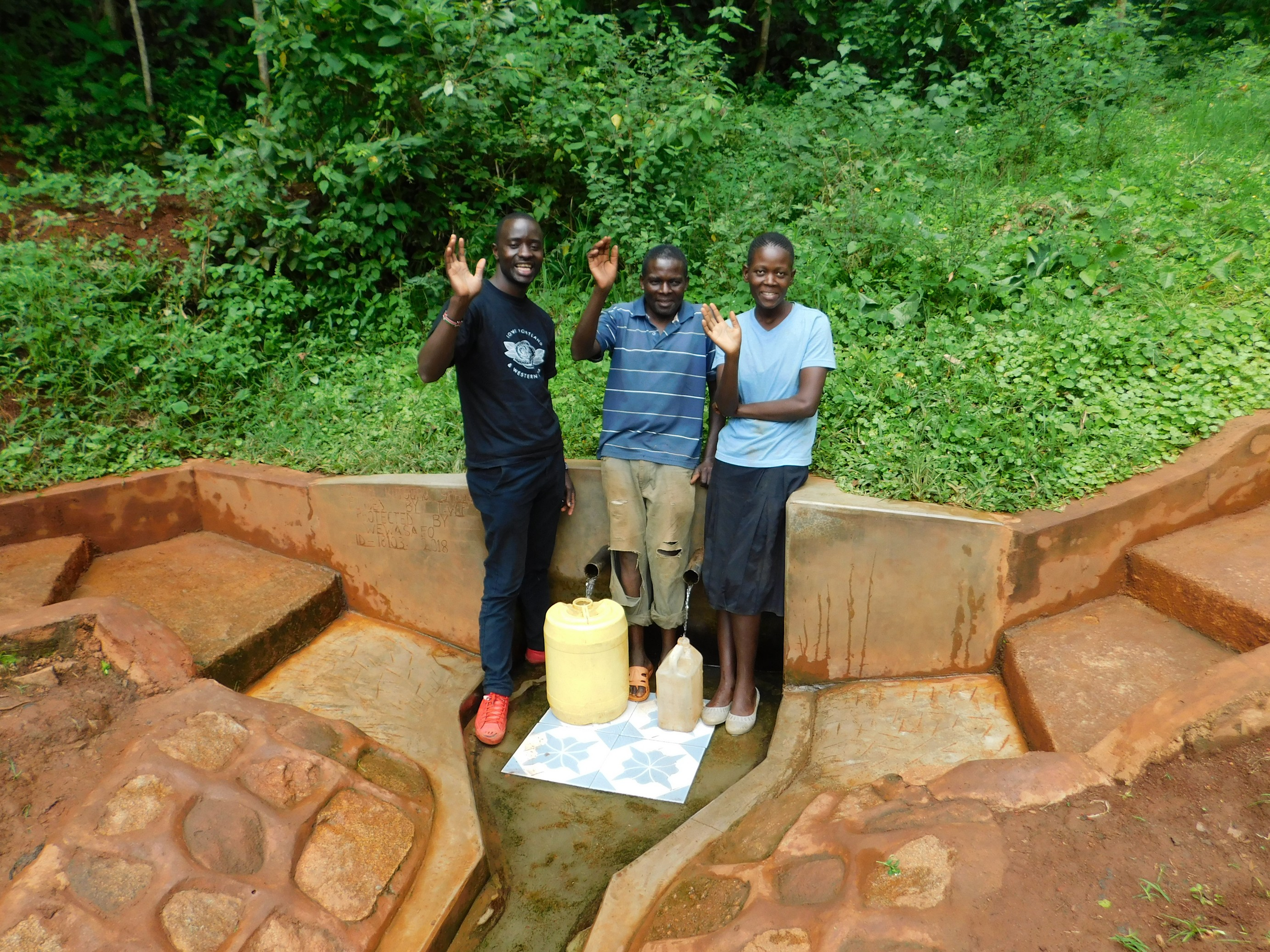 The Water Project : 3-kenya18103-field-officer-erick-wagaka-with-aineas-and-christine