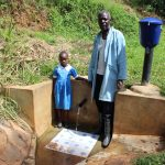 The Water Project: Jivovoli Community, Gideon Asonga Spring -  Samuel With Natasha Lungaso
