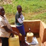 The Water Project: Lwangele Community, Machayo Spring -  Pamela And Boy At Spring