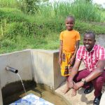 The Water Project: Indete Community, Udi Spring -  Gloria With Field Officer Jonathan Mutai