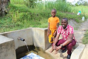 The Water Project:  Gloria With Field Officer Jonathan Mutai