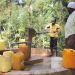 The Water Project: Munungo Community -  Nickson And Paul At The Well