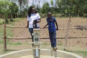 The Water Project:  Brian With Field Officer Terry At The Well
