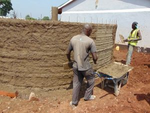 The Water Project:  Cementing Tank Walls