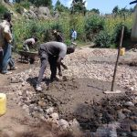 The Water Project: Kapchorwa Primary School -  Adding Cement To Tank Foundation
