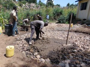 The Water Project:  Adding Cement To Tank Foundation
