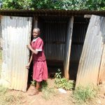 The Water Project: Ebukhuliti Primary School -  Girl Closes Latrine Door