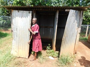 The Water Project:  Girl Closes Latrine Door