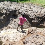 The Water Project: Shihingo Community, Inzuka Spring -  Young Boy Helps Excavate