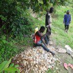 The Water Project: Eshikhugula Community, Shaban Opuka Spring -  Breaking Stones