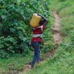 The Water Project: Kimarani Community, Kipsiro Spring -  Carrying Water Homejpg