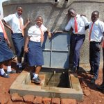 The Water Project: Ikumba Secondary School -  Students Pose With Tank