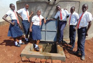 The Water Project:  Students Pose With Tank