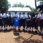 The Water Project: Ikumba Secondary School -  Girls Pose With Handwashing Station