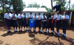 The Water Project:  Girls Pose With Handwashing Station