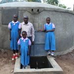 The Water Project: Kapchorwa Primary School -  Students And Staff At The Rain Tank