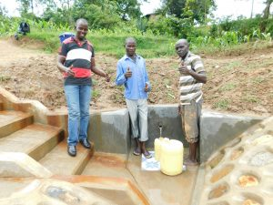 The Water Project:  Field Officer Jonathan With Community Members