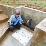 The Water Project: Mutao Community, Kenya Spring -  Thumbs Up For Clean Water
